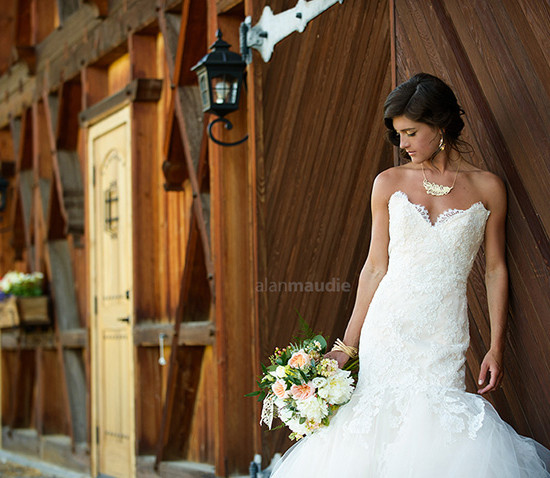 bride with wood backdrop